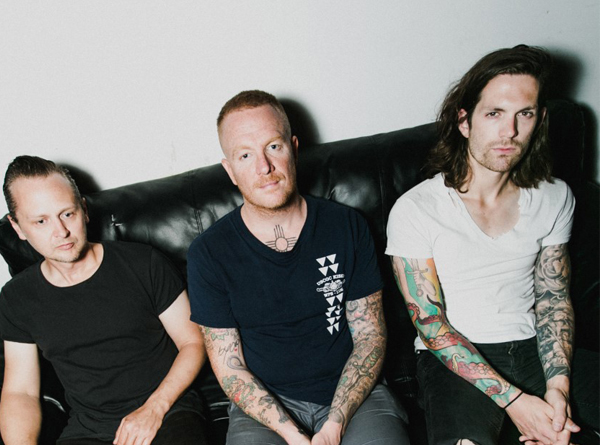 Eve 6 band members sitting on couch