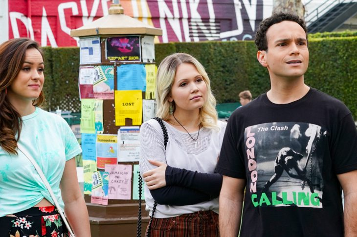 Scene still from the Goldbergs. Erica, Ren, & Barry on college campus