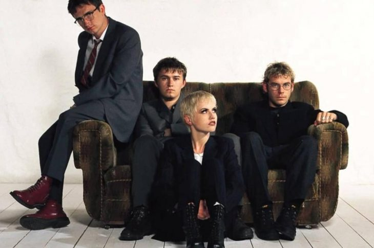 No Need To Argue album artwork - band sitting on couch in white room