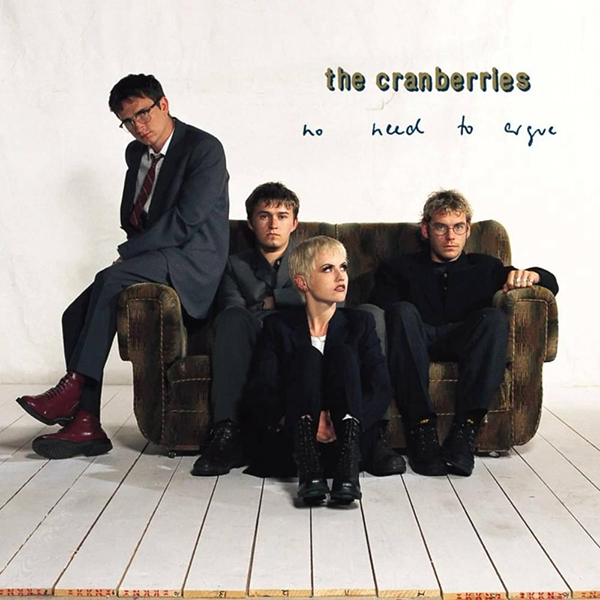 The Cranberries - No Need To Argue album artwork. Band sitting on couch in white room.