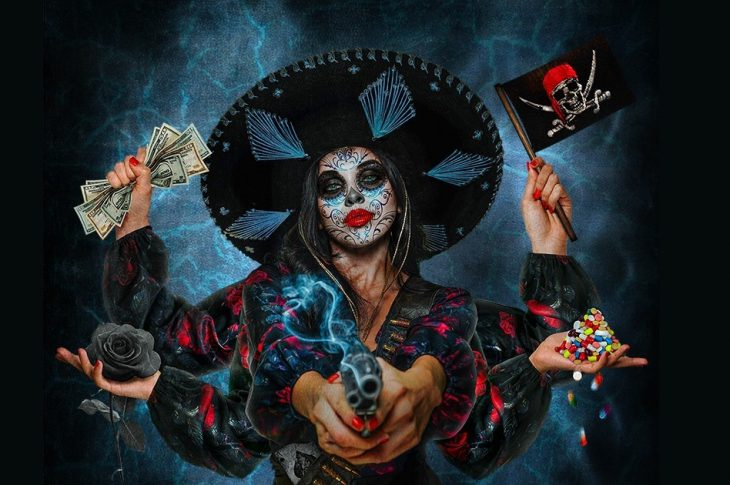 Album artwork for Let The Bad Times Roll. Artist rendering of a female bandito with 6 arms