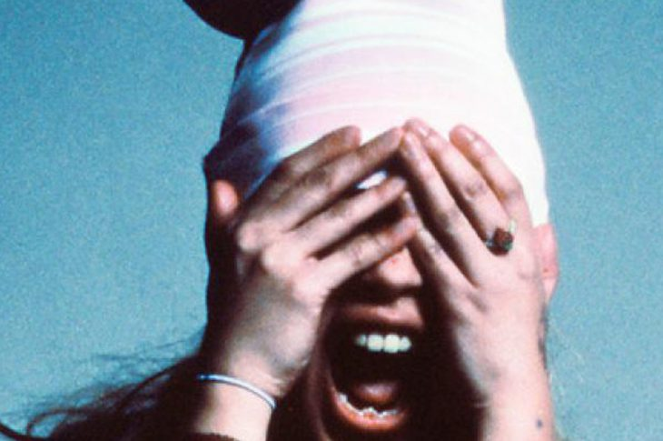 single artwork for Beabadoobee's Last Day On Earth. Photo of artist with hands over her eyes.