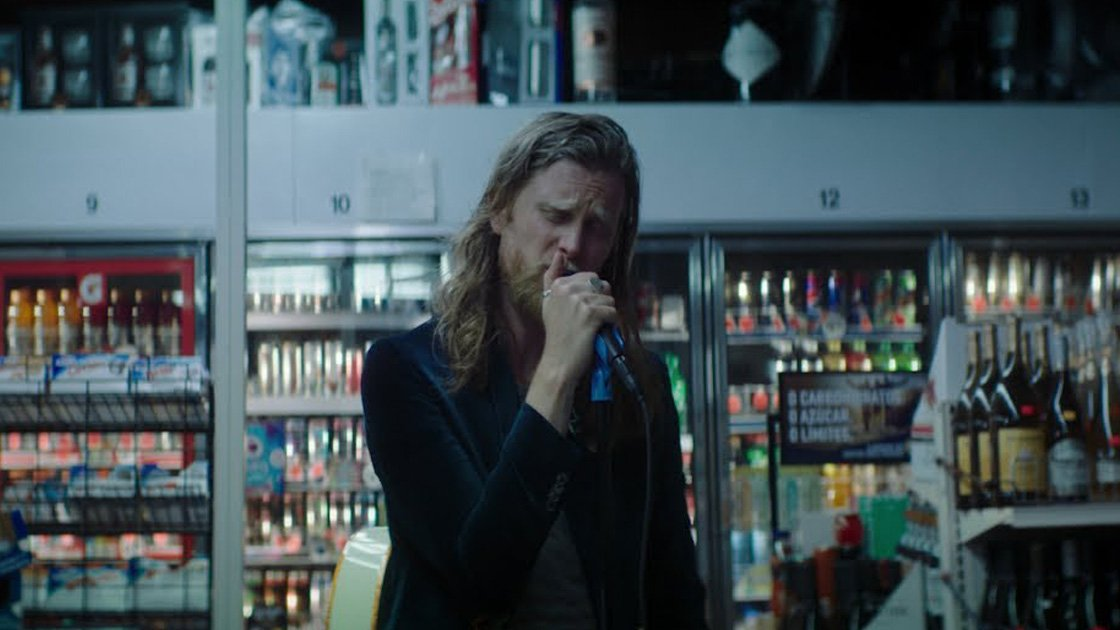The Lumineers frontman Wesley Schultz singing in a convenience store