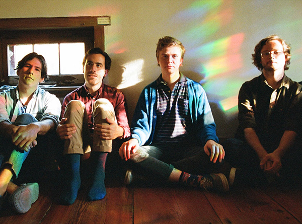 Pinegrove band photo. 4 members sitting on the floor