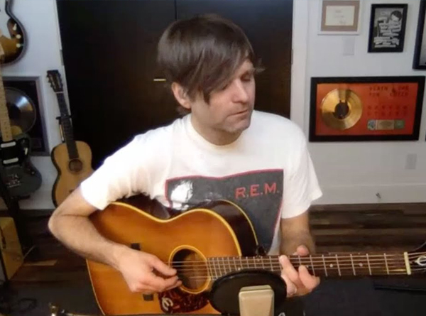 Picture of Ben Gibbard with a guitar in his home