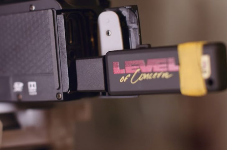 Screen shot of music video; USB drive in back of video camera