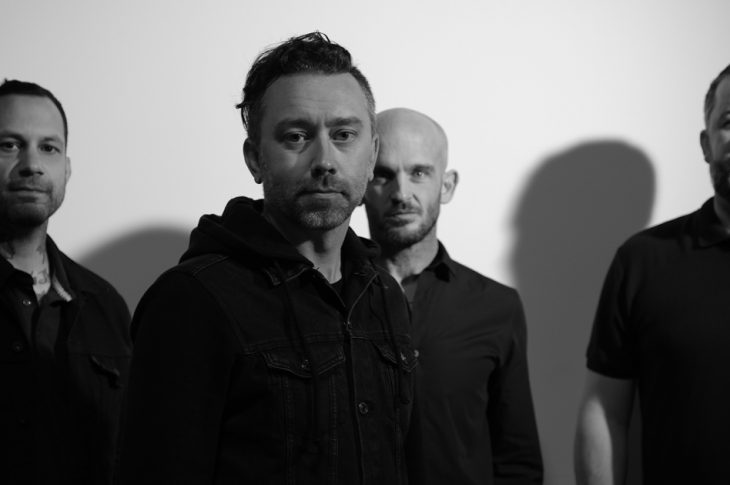 Black & White photo of Rise Against band members. Photo by Wyatt Troll